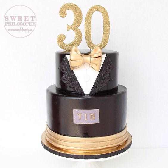 Sophisticated tuxedo cake with a touch of @sweet.philosophy sparkle!  #dirty30 #tuxedo #cake #tuxedocake #hisbirthday #birthdaycakes #bowtie #monogram #blackandgold #gtaevents #gtaweddings #torontoevents #torontoweddings #weddingcake #sweetphilosophy