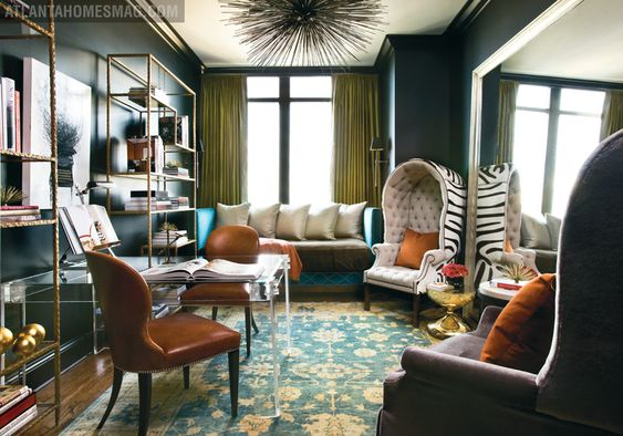 More over the top than I typically go for but that plexiglass desk, etageres and that zebra chair are insane good.  Room by Amy D. Morris