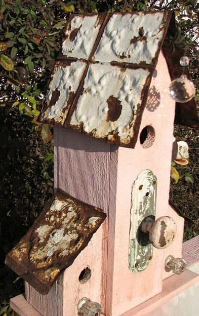 pink and rusty birdhouse
