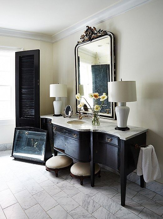 Darryl Carter, known for for his refined eye for antiques, filled his master bath with finds carefully cultivated over years and years of frequenting flea markets and vintage shops.