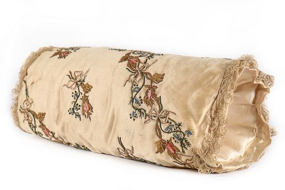 Muff, France, 1770s-1780s. Cream silk satin, delicately worked with moss rose and borage bands, edged in lace.: