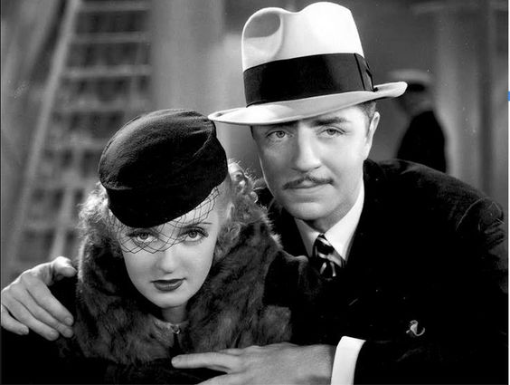 A glamorous Bette Davis and an always debonair William Powell in FASHIONS OF 1934 (1934).********* Un Glamuroso Bette Davis y un elegante siempre William Powell en la moda de 1934 (1934).