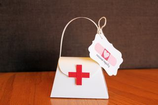 Stampin' Up! First Aid Kit Purse. Would be cute to give out to nurses or to a friend in need of a little pick me up.