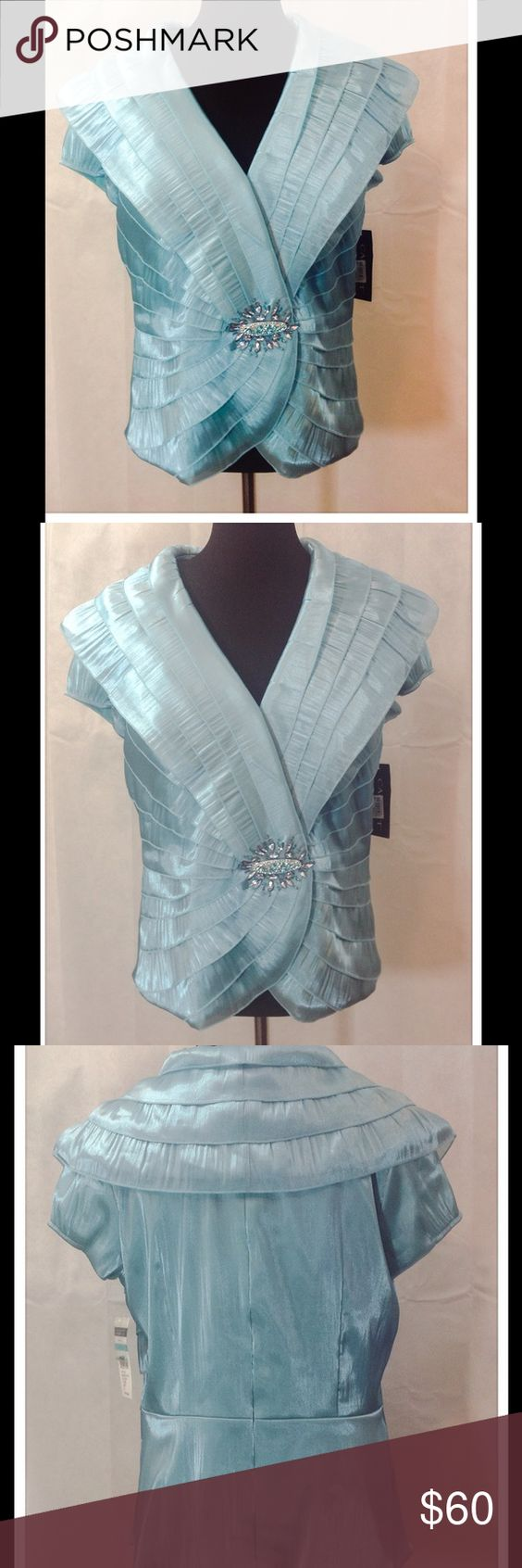 NWT Turquoise Cachet Blouse You'll be ready for the holiday festivities with this beautiful blouse. Beautifully appliqués in front and zIppered back. Pair it with dressy slacks or a skirt, and you're ready!  Dry Clean. Cachet Tops Blouses