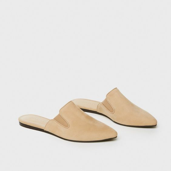 The Jenni Kayne Mule Slide is our secret for effortless style. A slip-on pointed toe flat with open back, our now-classic mule slide is hand-crafted in Italy in natural oiled leather with a matte fini
