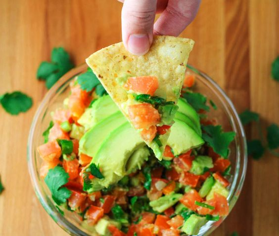 This Fiesta Avocado Salsa is a crowd favorite! It's perfect for your next holiday or get together!   http://Tastefulventure.com