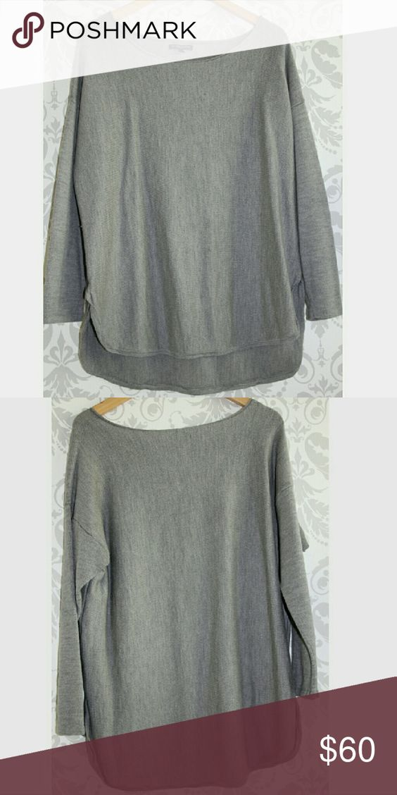 Plus - Eileen Fisher Shirttail Hem Merino Sweater 100% Merino Wool. Light grey color. Excellent condition; minor pilling but no damage to the shirt. Size is 2X, though this style I did find to be a more form-fitting style than you might expect from Eileen, so you may wish to size up. Beautiful piece for your wardrobe; easy to dress up with a scarf or statement necklace. Material is light but still quite warm. Eileen Fisher Sweaters Crew & Scoop Necks