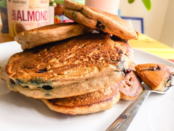 Fluffy Blueberry Cinnamon Pancakes. These healthy pancakes were inspired by a lonely banana on a cloudy Sunday morning. Sitting on my counter, too ripe to eat, but perfect for baking. I always have frozen blueberries on hand, but you can use any fruit of your choosing as long as they cook well with the batter (eg. apple, raspberry, strawberry). The blueberries add a tart and sweet tang and the heart-healthy cinnamon adds a warm spice to these little cakes. #GlutenFree | VibrantMethod.com