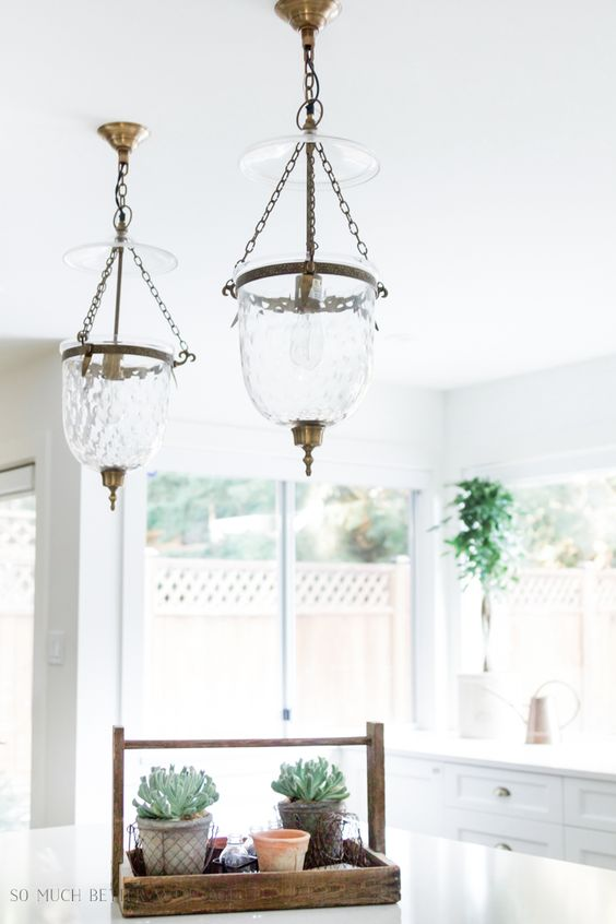 Love urn style pendant lights for your kitchen? I get asked about where I found this lighting for my kitchen all the time! On the blog, I'm sharing similar urn style pendant light fixtures and where you can buy them online. #lighting #KitchenPendants #pendants #kitchenlighting #Lightfixtures #somuchbetterwithage