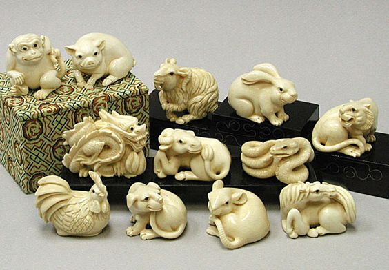 Mammoth ivory Chinese Zodiac carvings -- rat, horse, dog, chicken, snake, ox, dragon, lion, hare, goat, pig, monkey.: