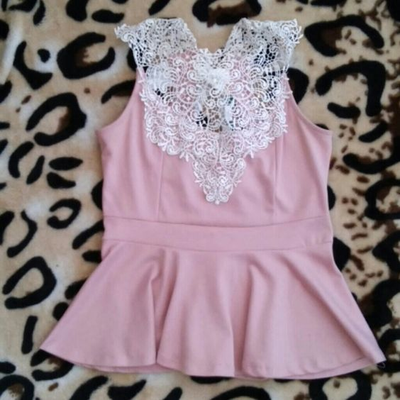 Peplum shirt Pink peplum shirt with front detailing and back ribbon bow. Tops