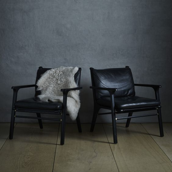 Black leather danish chairs.