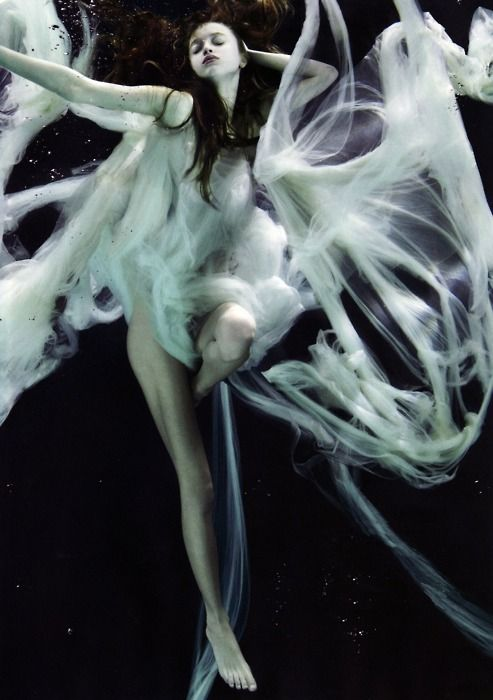 I want to get an underwater bag so I can shoot something like this! I wish that she was in black on a white background- it reminds me of a spider!