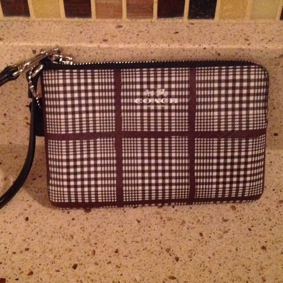 Coach wristlet Practical brand new!  Received for Christmas and never used.  Brown, and black plaid design Coach Bags Clutches & Wristlets