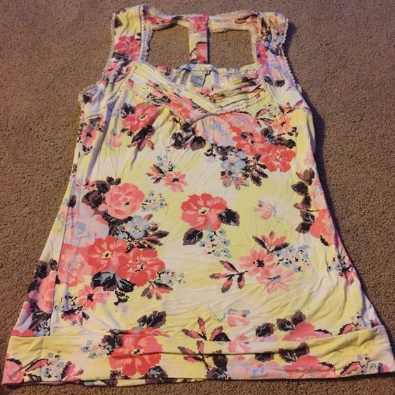 American Rag Tank Top I absolutely love this shirt! It has such a cute cut on the back. It is a pale yellow color with salmon colored flowers. Obsessed with the back of this shirt! Wish it still fit me! American Rag Tops Tank Tops