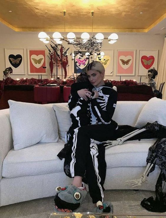 Baby's First Halloween from Kylie Jenner's Halloween Costumes Through the Years For her annual Halloween dinner party in 2018, Kylie and Stormi match in skeleton onesies.