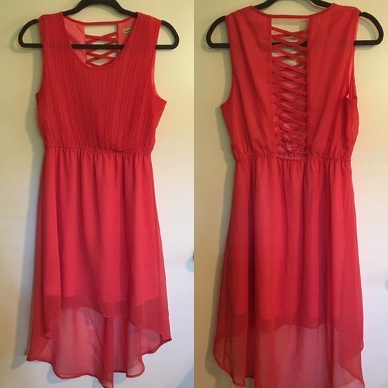 Coral high low dress Perfect for summer weddings or nights out. Detailed back makes for a fun surprise when you turn around. Pairs well with tan or black heels and turquoise Jewlery. Altar'd State Dresses High Low