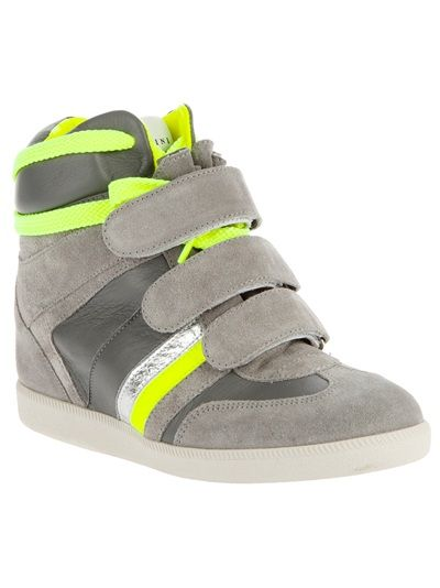 Umm yes please.  What do I like more, the velcro straps, the concealed high wedge heel or the neon yellow details.