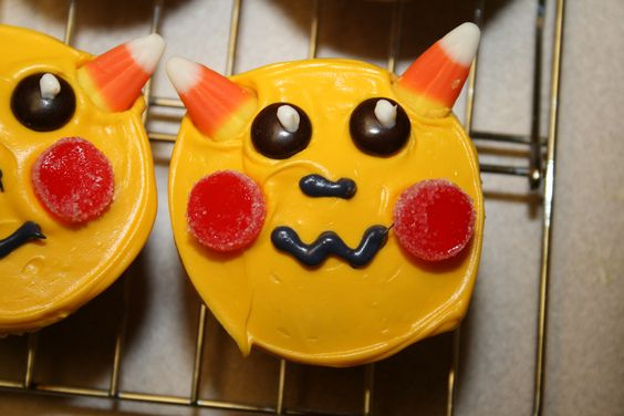 Pokemon Pikachu cupcake, created for my son's birthday - candy corn ears, slices of gumdrops for cheeks, M&Ms for eyes, and frosting for the rest