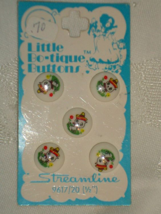 "ButtonArtMuseum.com - 3 Cards Vintage White Plastic Buttons With Painted Mexican Chihuahuas - three cards of vintage white plastic buttons with painted Mexican Chihuahua dogs wearing colorful sombreros come from an estate in mid-Michigan and is in excellent unused condition.  These are ½"" wide buttons on a Little Bo-tique Buttons card by Streamline and are made in Japan.  All three cards have five buttons.  The cards indicate these are washable"