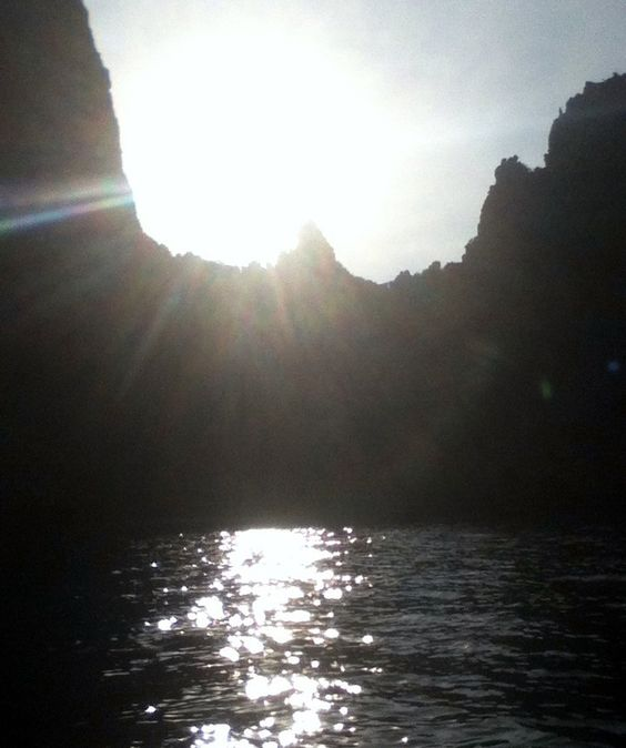 The sun diving below the cliff-side at Maya Beach