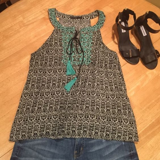 Sleeveless top THML rayon tank. Black and white print with bright teal stitching and a bright teal tassel. This was a StitchFix item THML Tops