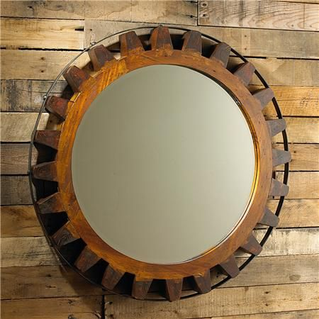 Wooden Gear Mirror A Solid Wood Carved Gear Is Straped With A Black Iron Strap For A Rustic Look