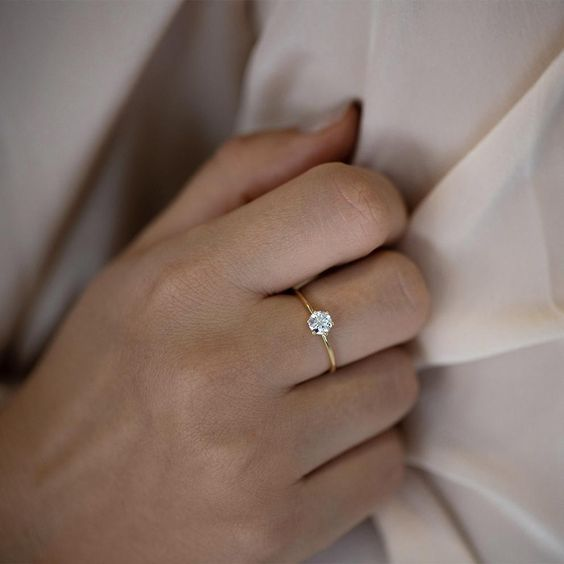 Solitaire Engagement Ring - Minimalist Diamond Ring on Hand Up Close