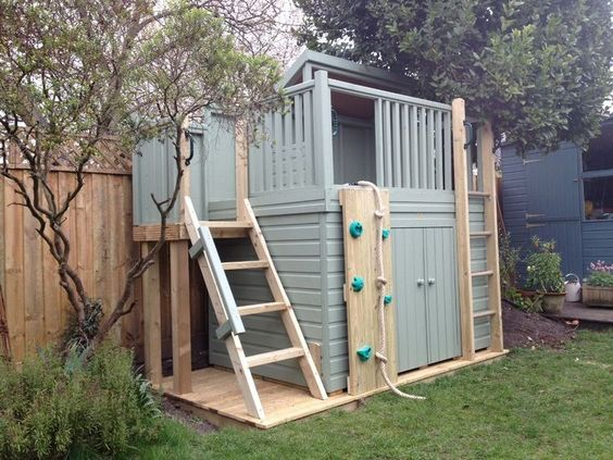 A treehouse shelter with a storage area underneath. The play shelter has 3 acces#acces #area #play #shelter #storage #treehouse