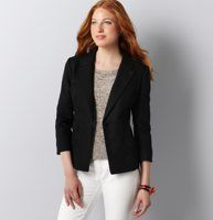 "Cotton/Linen Blazer - Lightweight and luxurious, this cotton/linen blazer is equal parts easygoing and polished. Notched lapel. 3/4 sleeves. Single button closure. Three flap pockets. Two-button cuffs. Fitted silhouette. Lined. 23 3/4"" long."