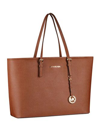 MICHAEL Michael Kors Jet Set Macbook Travel Tote - can hold my Macbook, iPad, and iPhone.  :)