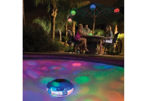 underwater light that makes water look technicolor...i want to dive into a rainbow!!