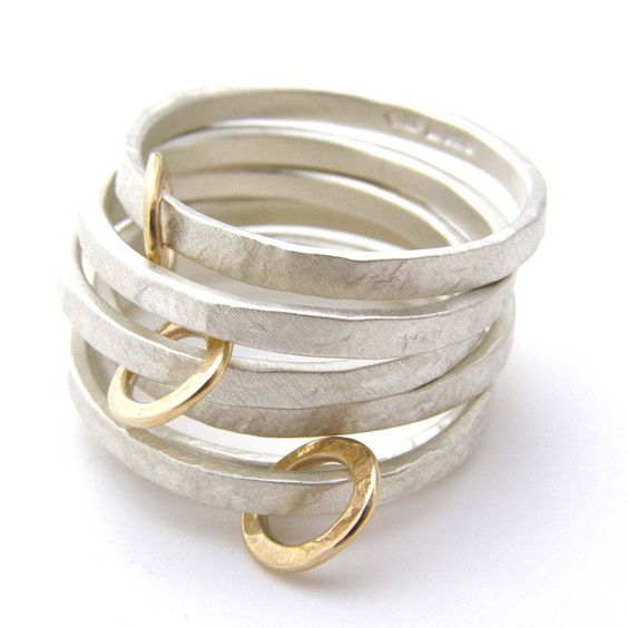 Beautiful hand made Silver and 9ct gold hoop rings by the fabulous British designer Jane Kenny.The image shows the silver with gold hoops rings mixed up with some of Janes plain silver rings. The price for each silver and gold hoop ring is £64. The plain silver rings are £44. If you do not know your ring size then this handy guide created by NOTH might help: http://www.notonthehighstreet.com/email/2013/partner_material/Ring-Size-Guide.pdfA long time favourite at Soremi Contemporary…