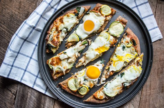 This Farmers Market Breakfast Pizza is full of late-summer vegetables, topped with an egg, and baked to a golden perfection.