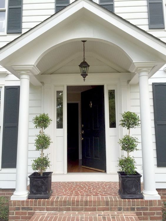 Our colonial home the before tour walkways entryway for Colonial front porch ideas