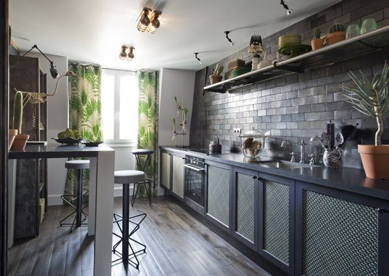 Masculine kitchen in a pied à terre in Paris, France designed by Hubert Zandberg