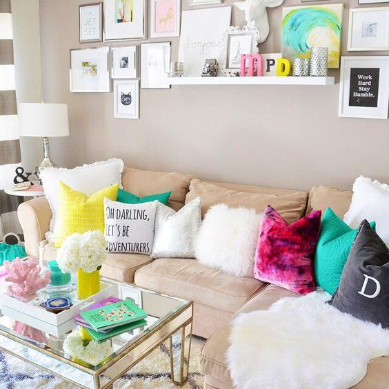 Beige couch bright color pillows pink teal yellow grey white texture cheery exciting living room for Bright colorful living room ideas