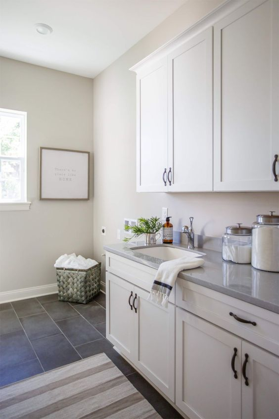 Laundry room in Worldly Gray by Cottage Home Company (Shuman Mabe Interiors, LLC)