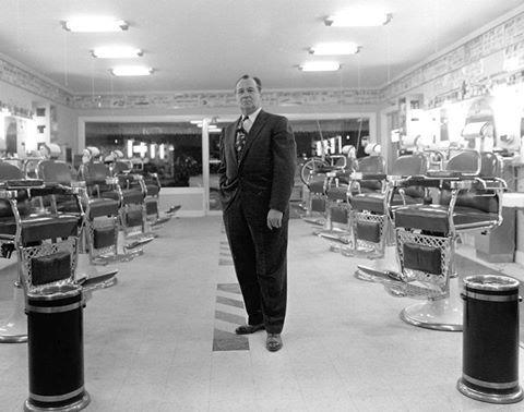 Sherman Beech, Sr. at his barber shop on South Magnolia. Laurel