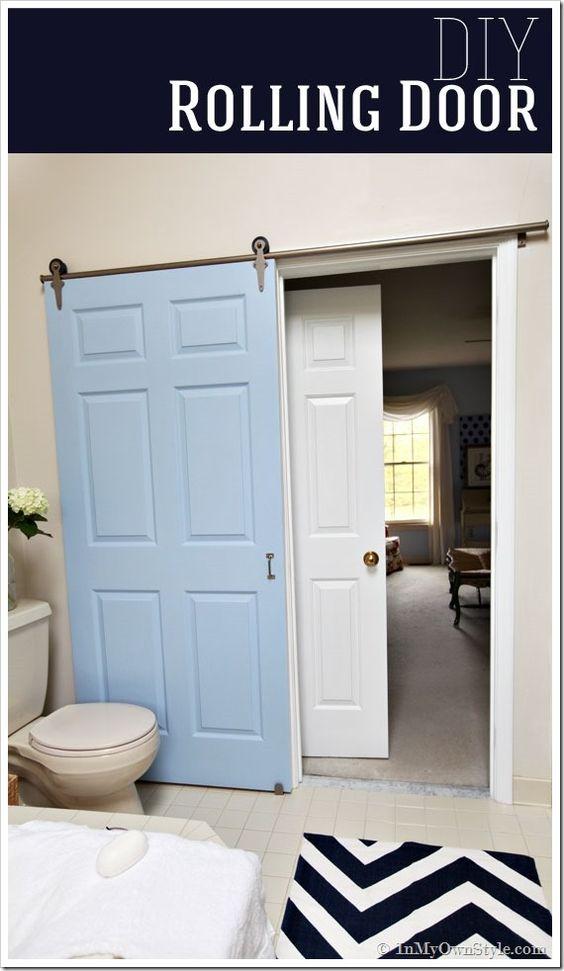 Bathroom gets a makeover using rolling door hardware for Hanging barn door in house