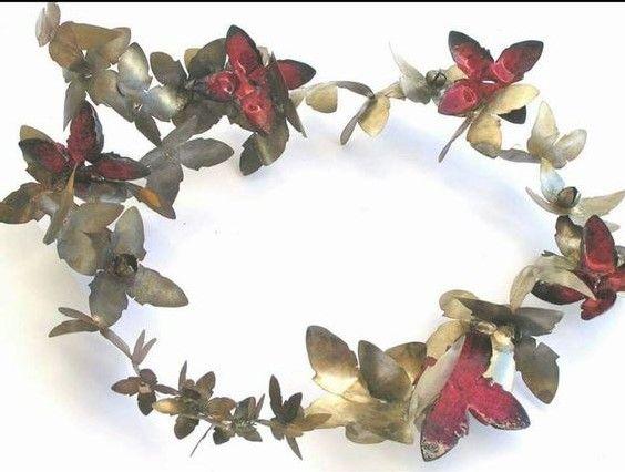Sara Shahak - flattened industrial metal bells, enamel:
