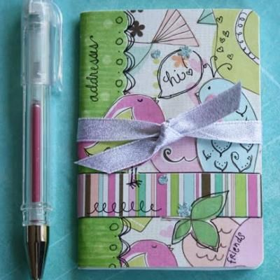 Mini address Book..covering it..man I never thought of this!  Definitely will next time instead of standing there forever to find the cutest one!!
