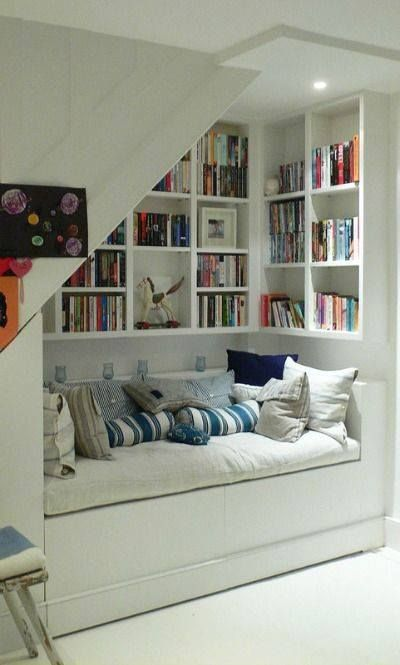 Don't know what to so with an 'under the stairs' area? This is a great use of space and introduces a cosy little reading area!