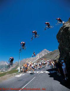 Tour de France 2003: Crazy on a mountain bike jumping the cycling peloton. Amazing