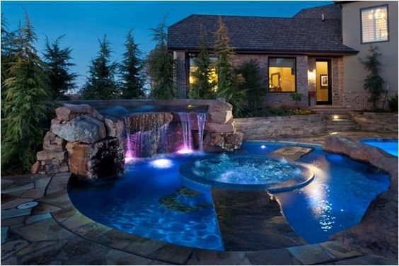 Pool with waterfall and hot tub