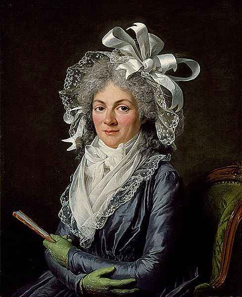 Adelaide Labille-Guiard paints Madame de Genlis (1780) in a bonnet of lace and ribbons.  Notice the green kid gloves, closed fan, and unfriendly pose.  She does not appear a kindly, warm woman, does she? ~Leah Marie Brown