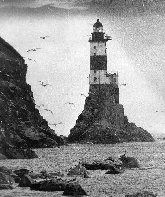 The Aniva lighthouse was built by the Japanese in 1939, on a chunk of rock off the southern coast of Sakhalin, a thin 950 km long island situated just east of Russia, between the sea of Japan and Russia's Sea of Okhotsk. The island was largely uninhabited until the 1800's, when both Japan and Russia became interested in annexing it; the Russians for use as a penal colony.