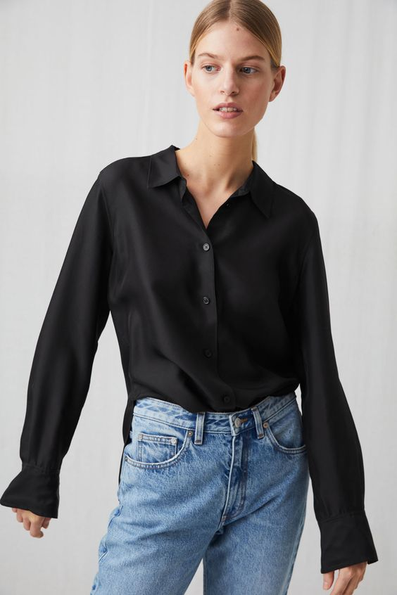 Model side image of Arket slim silk shirt in black