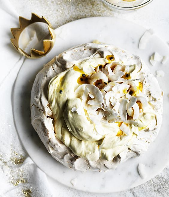 Australian Gourmet Traveller recipe for coconut pavlova with passionfruit jam and lychees.