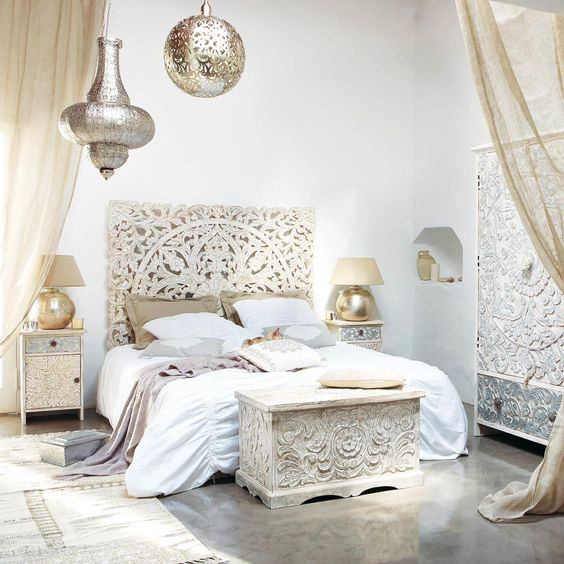 All the carved wood furniture is absolutely stunning, including the white wash. Moroccan lantern, gold sphere lamps